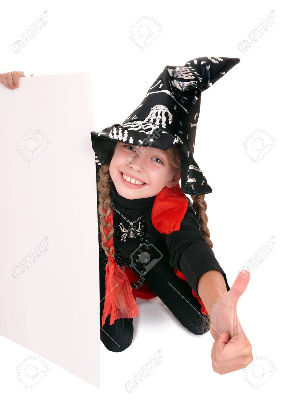 Child  witch holding banner and thumb up. Isolated. Stock Photo - 7888636