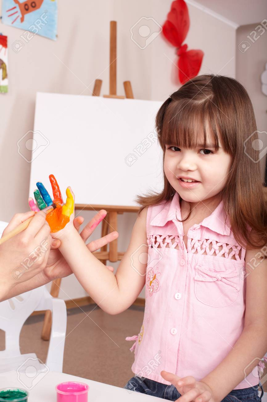 Little girl  making hand prints. Stock Photo - 7890054