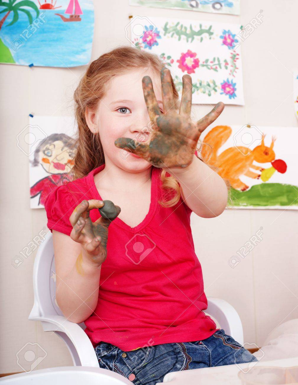 Little girl playing with clay in play room. Stock Photo - 7889963