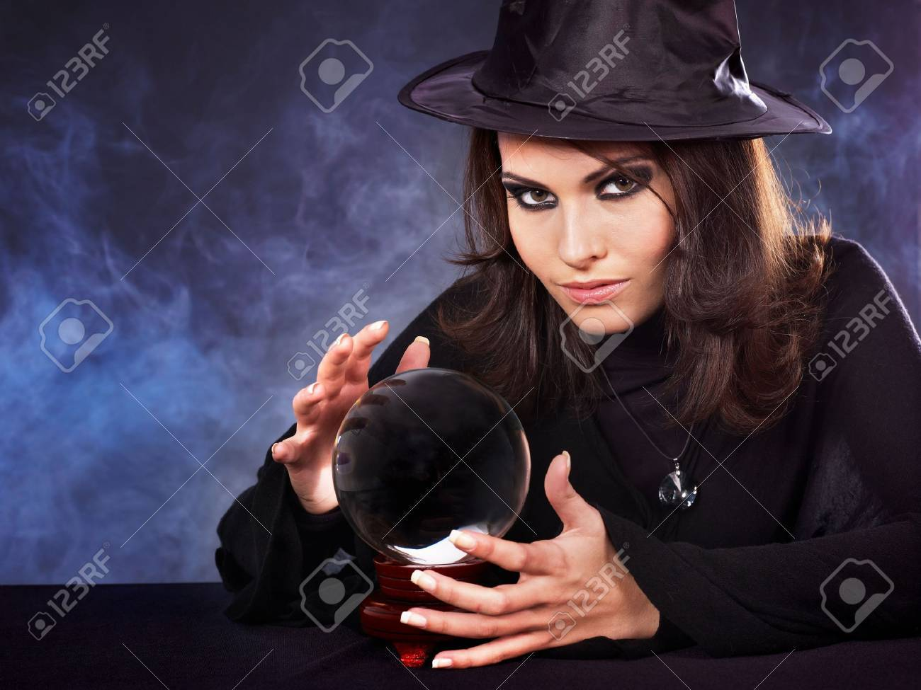 Young beautiful woman with crystal ball. Stock Photo - 7890178