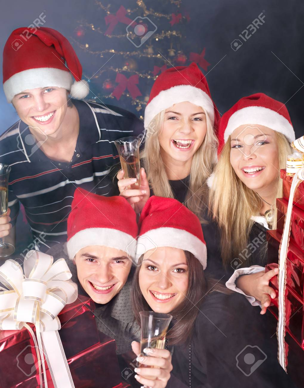 Group young people in santa hat drink champagne at nightclub. Stock Photo - 7890182