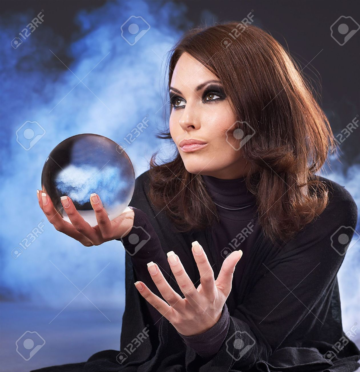 Young beautiful woman with crystal ball. Stock Photo - 7890186