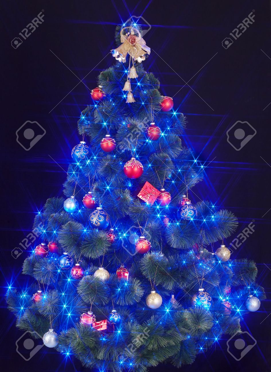 Christmas Tree With Light And Blue Star Black Background