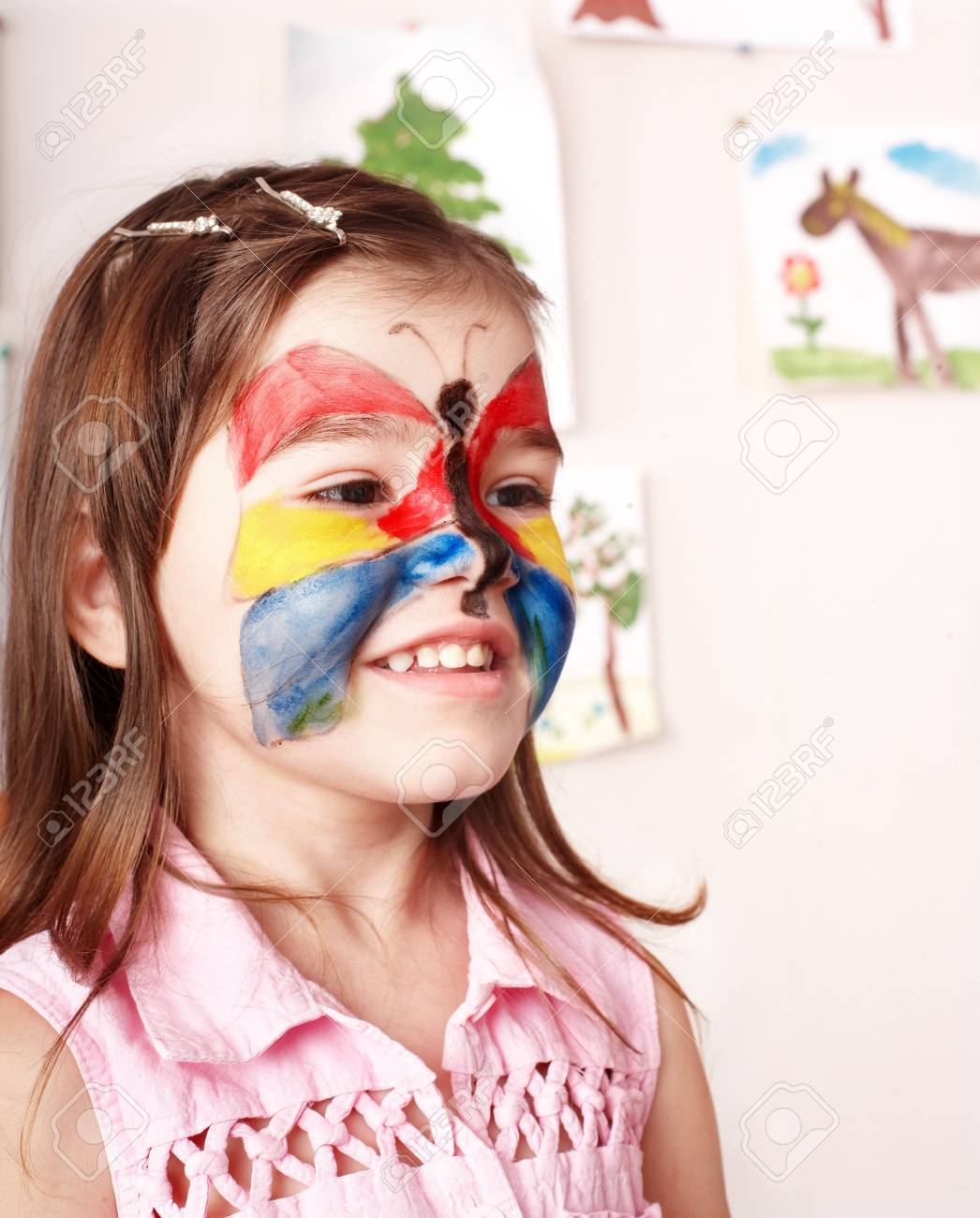 Little girl  making face painting. Stock Photo - 8239245