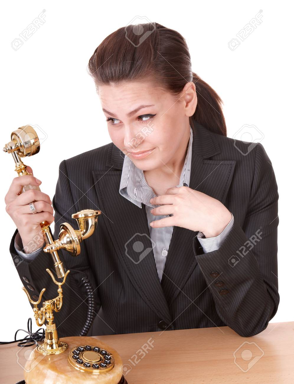 Happy businesswoman with golden phone. Isolated. Stock Photo - 8239289
