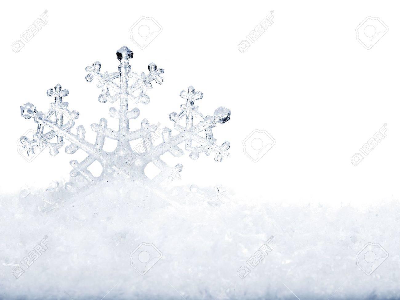 Snowflake in white snow. Isolated. Stock Photo - 8227253