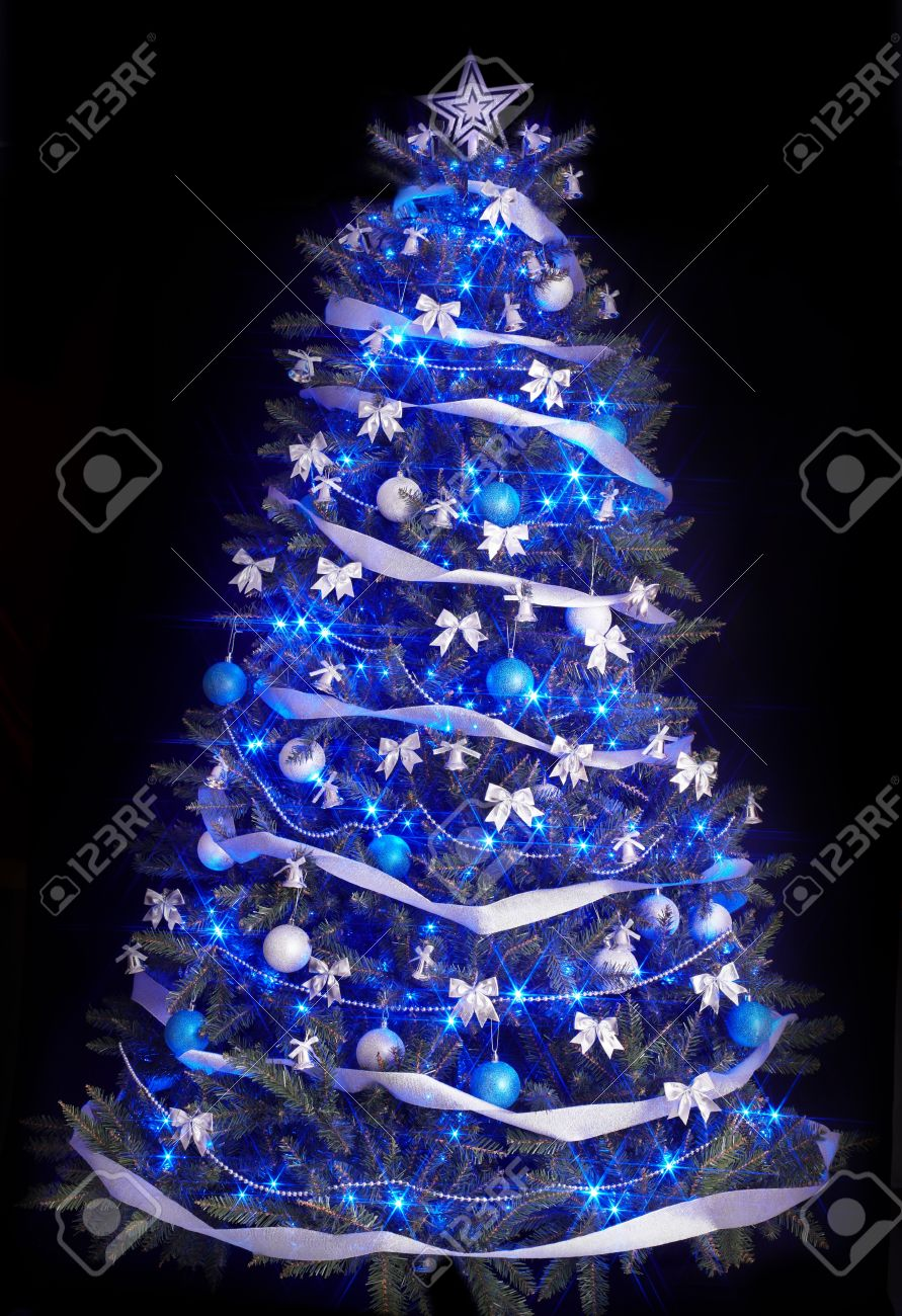 Christmas Tree With Lights.Christmas Tree With Light And Blue Star Black Background
