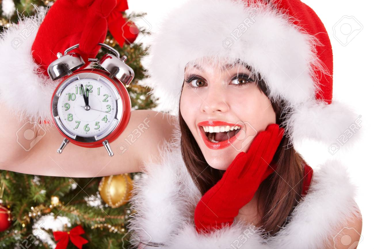 Christmas girl in santa hat holding stack  gift box.  Isolated. Stock Photo - 8405114