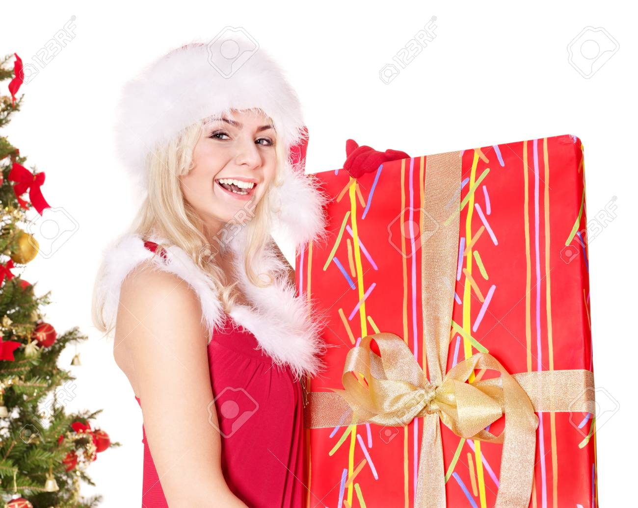 Girl in santa hat holding  gift box by christmas tree.. Isolated. Stock Photo - 8405191