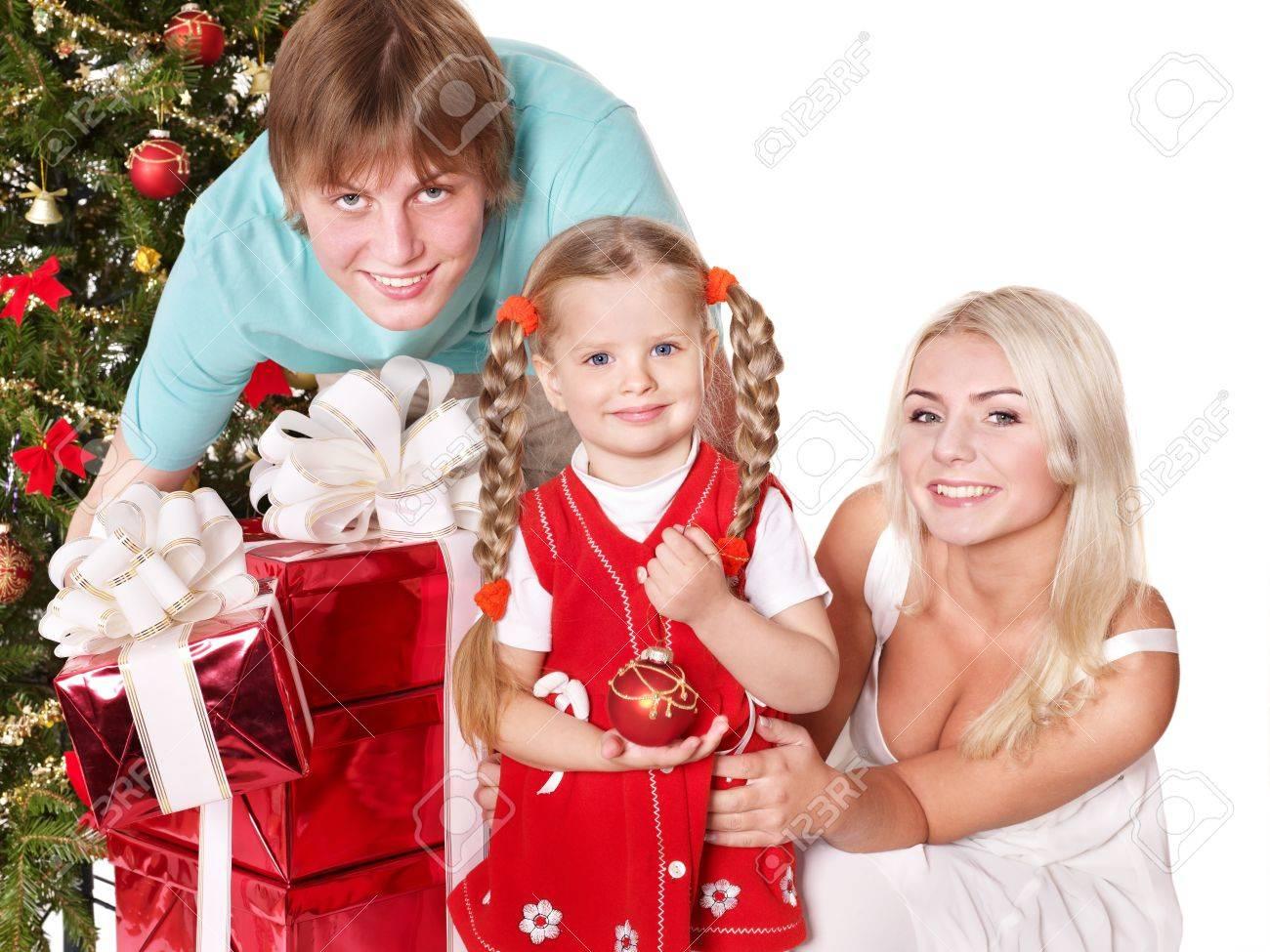 Happy family in santa hat holding gift box.  Isolated. Stock Photo - 8405188