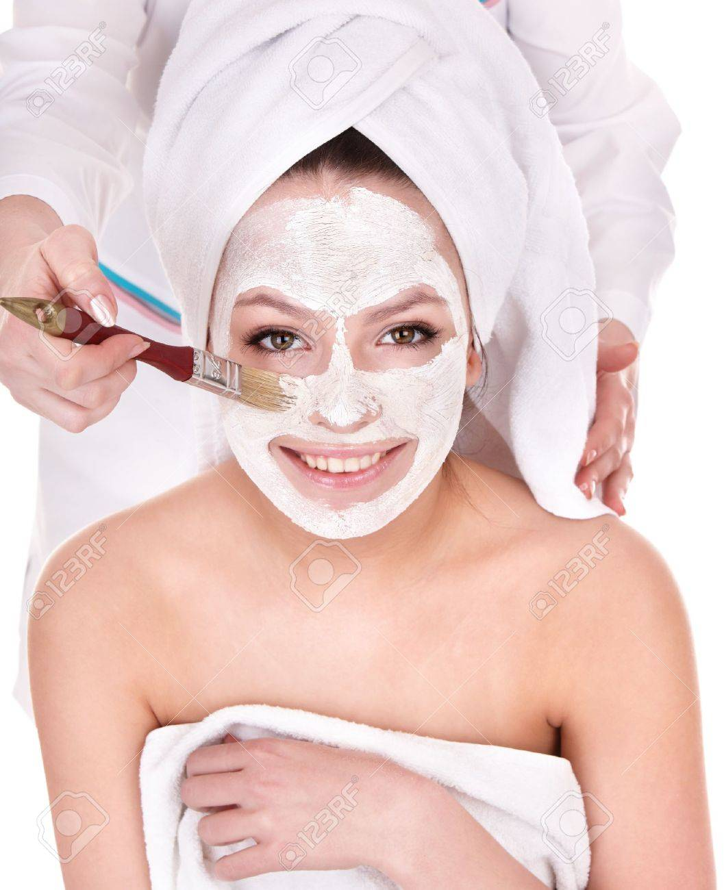 Young woman with clay facial mask. Stock Photo - 8332657