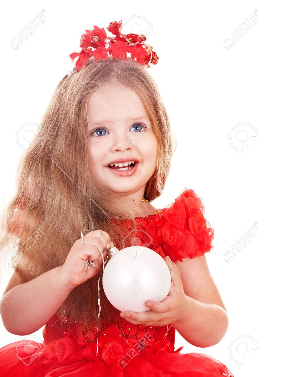 Little girl in red santa hat holding christmas ball. Isolated. Stock Photo - 8332744