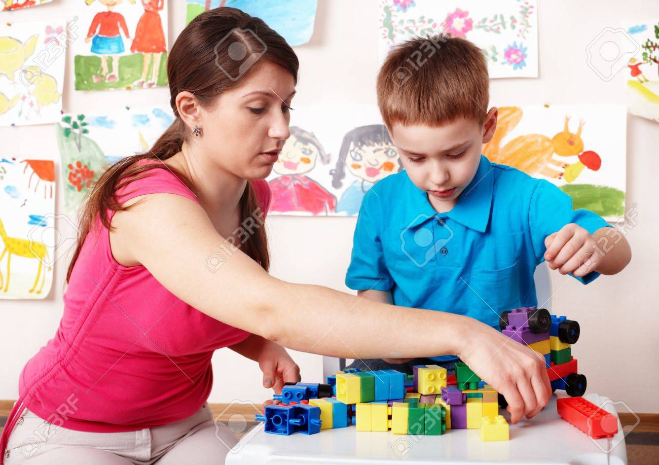 Child with construction in play room. Preschool. - 8332758