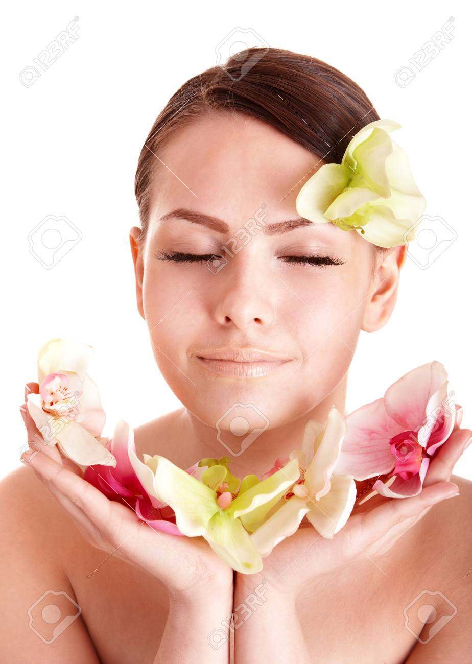 Beautiful girl with orhid flower in spa . Isolated. Stock Photo - 8332703