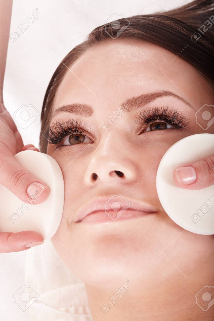 Young woman washing her face by sponge. Stock Photo - 8332751