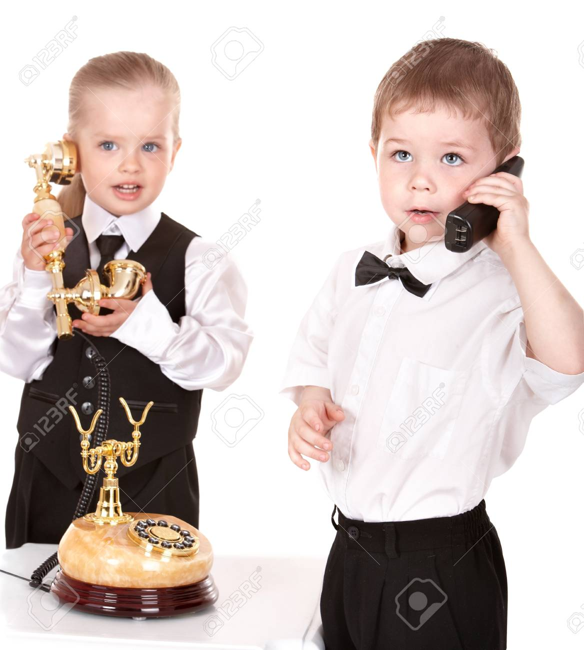 Children in business suit with telephone. Isolated. Stock Photo - 8332627