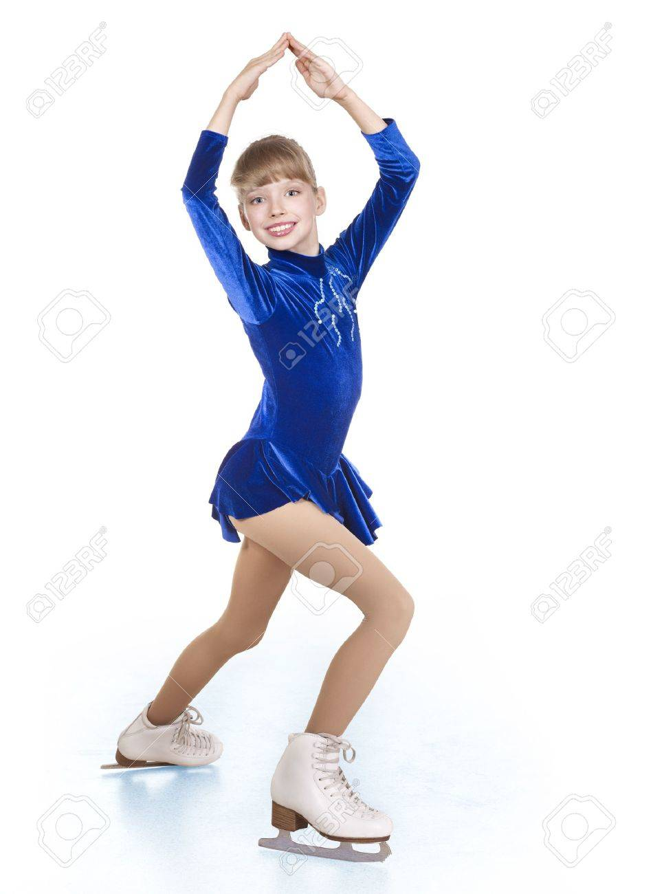 Happy young girl figure skating. Isolated. Stock Photo - 8383342