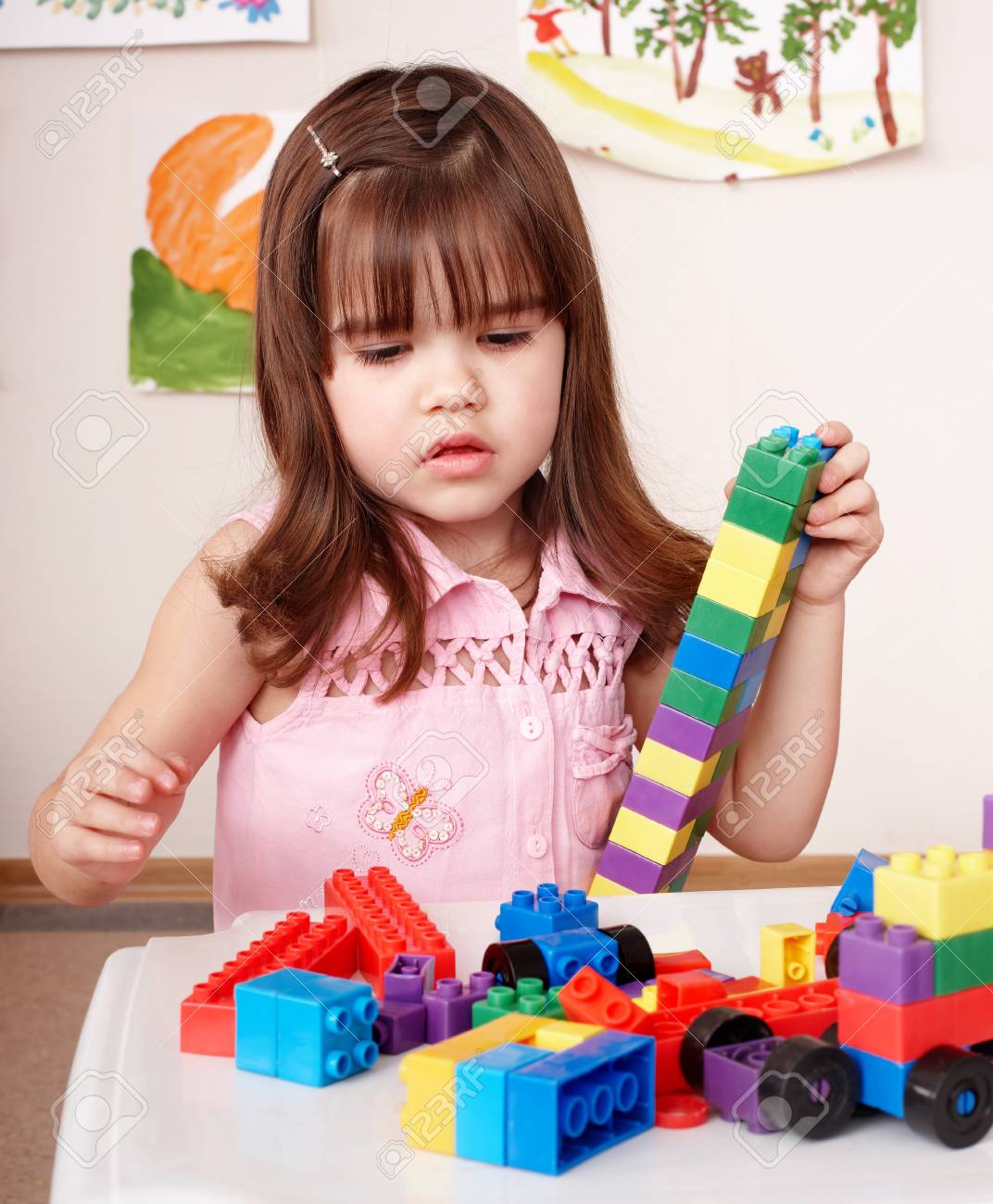Child preschooler with construction set in play room. Stock Photo - 8781433