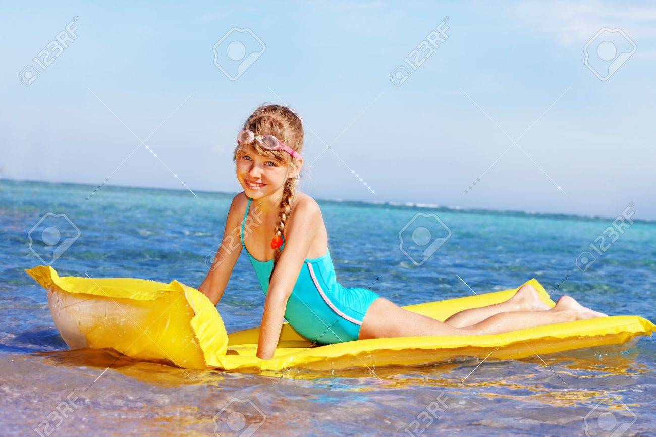 Little girl swimming inflatable beach mattress. Stock Photo - 8781879