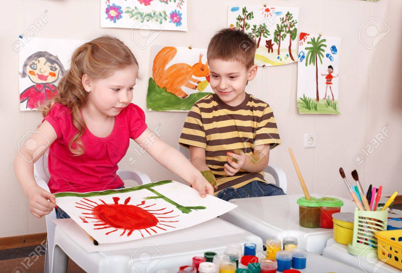 Children painting in play room. Child care. Stock Photo - 9093874
