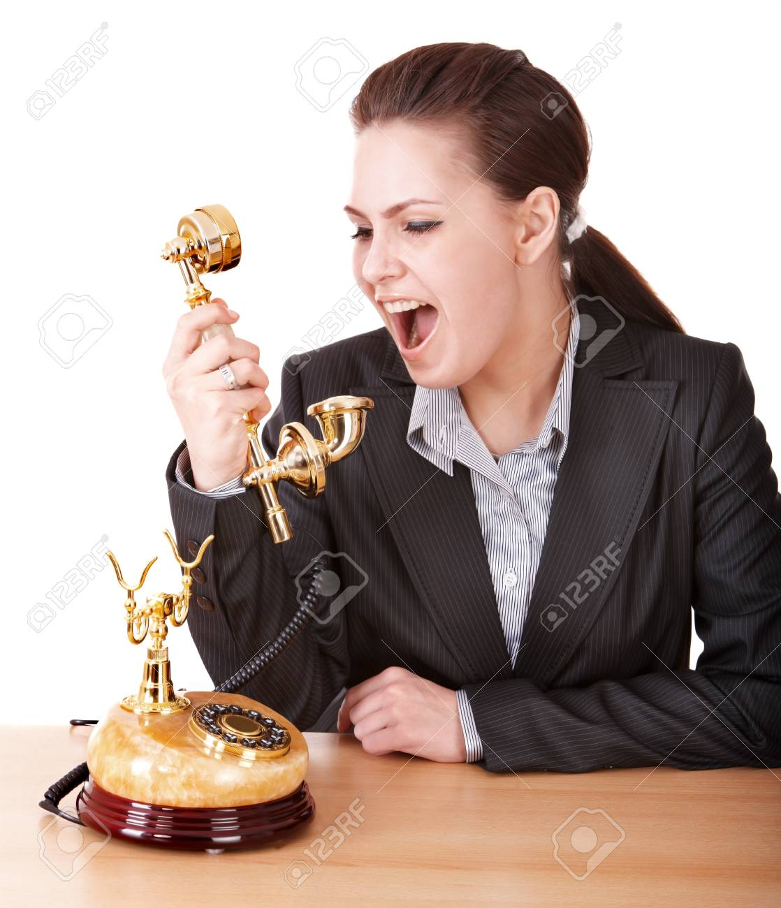 Aggressive businesswoman with phone. Isolated. Stock Photo - 9093798