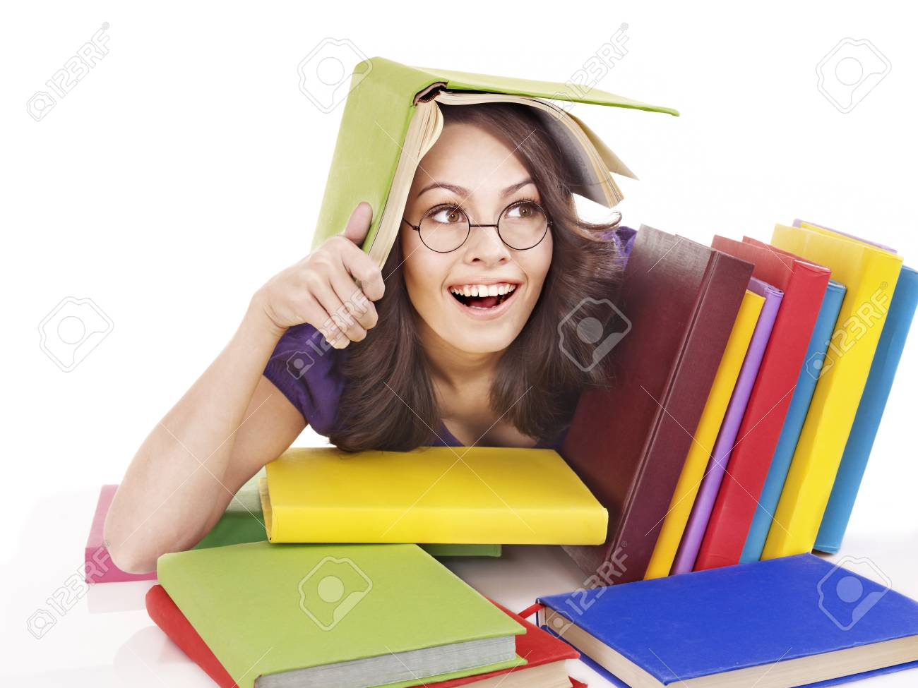 Girl in glasses with stack book . Isolated. Stock Photo - 9284249