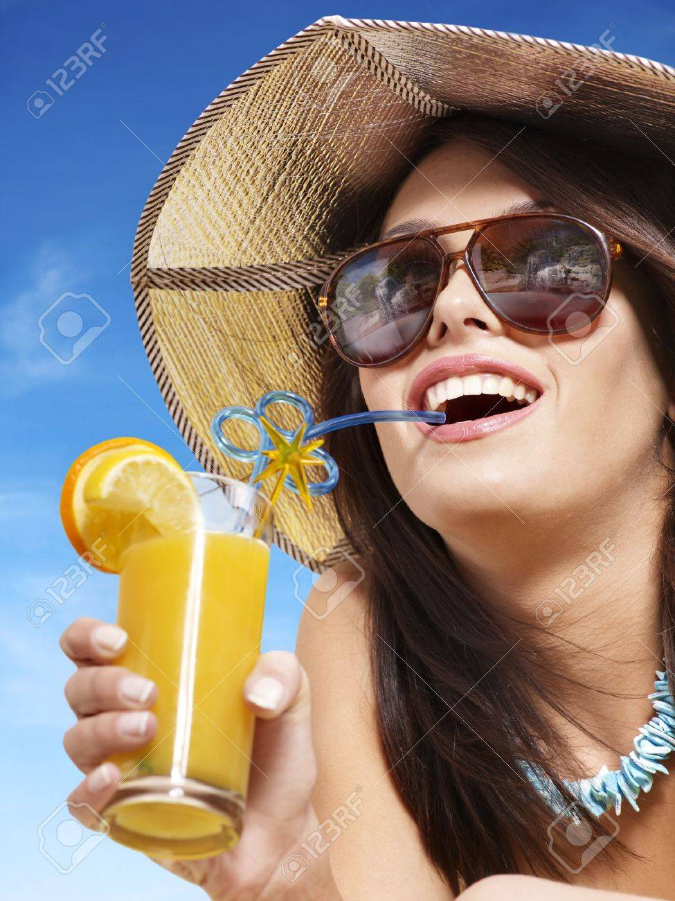 Girl in bikini drink juice through a straw. - 9385732