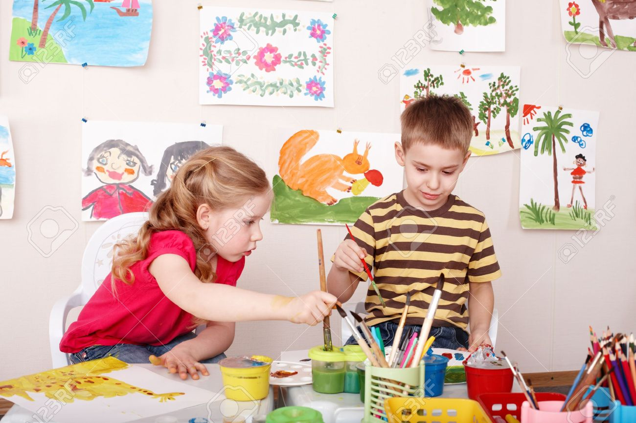 Children painting in play room. Child care. Stock Photo - 9392328
