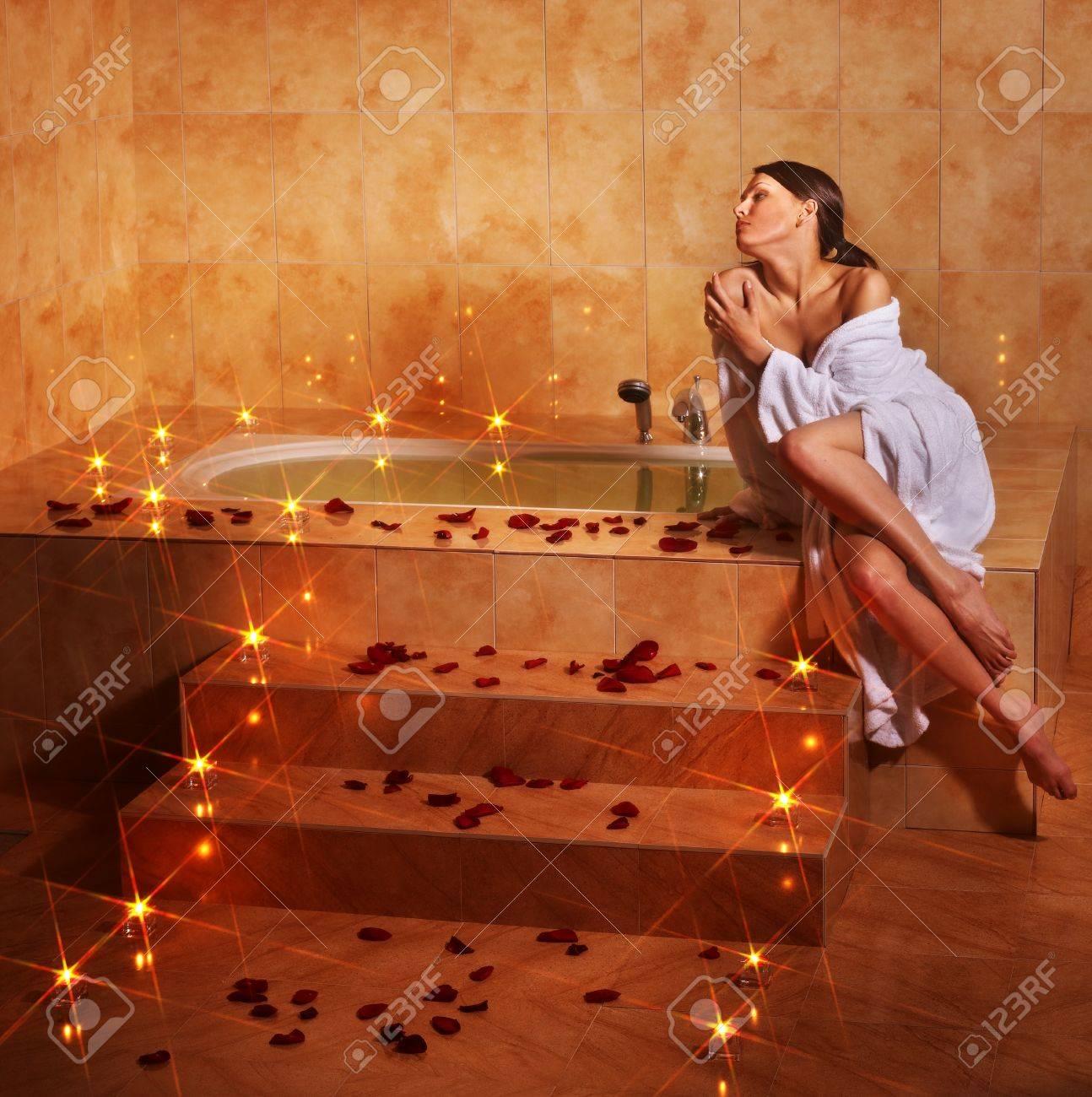 Woman sitting on edge of bath tub. Stock Photo - 9526729