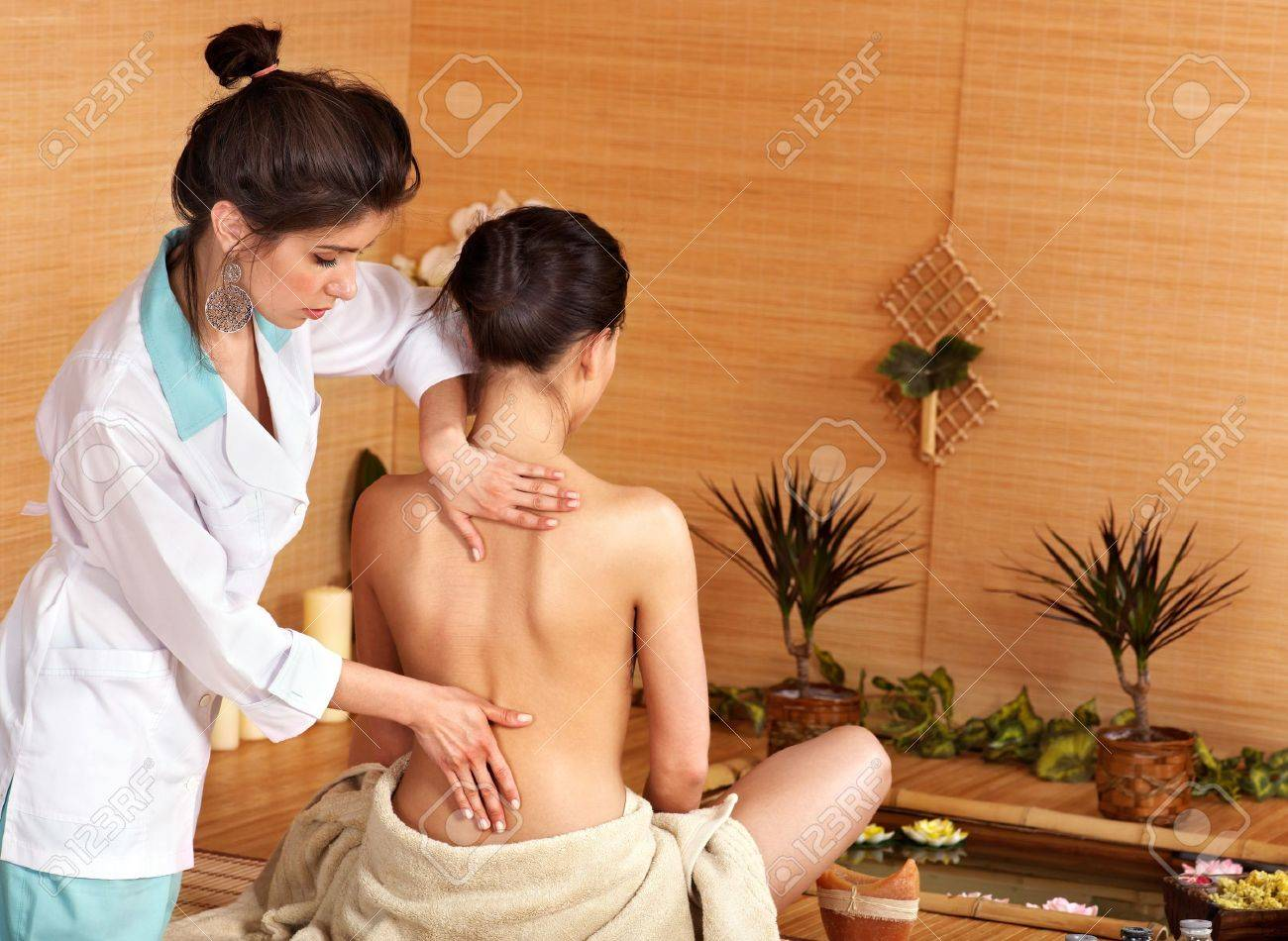 Young woman getting massage in bamboo spa.. Stock Photo - 9620296