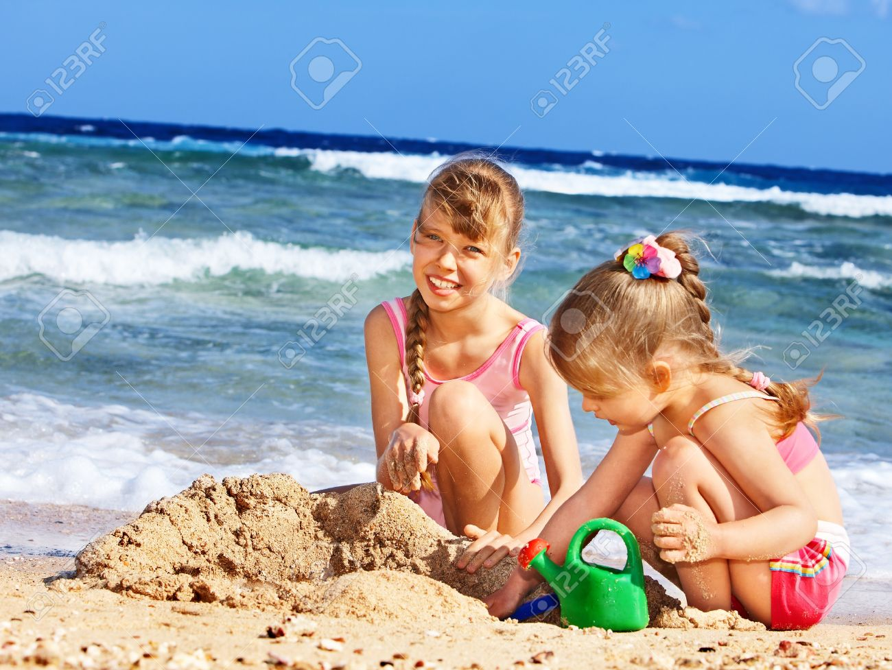 http://previews.123rf.com/images/poznyakov/poznyakov1106/poznyakov110600229/9780810-Little-girl-playing-on-beach--Stock-Photo-sand-children-beach.jpg