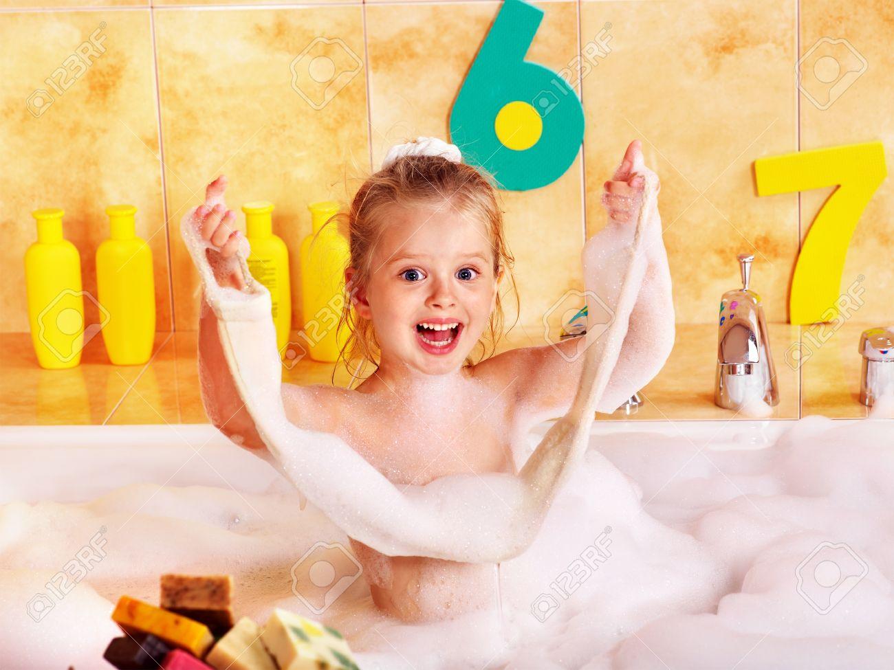 Child washing in bubble bath . Stock Photo - 9897942