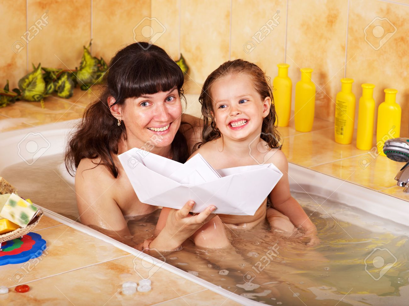 Mother and child washing in bubble bath . Stock Photo - 9898583