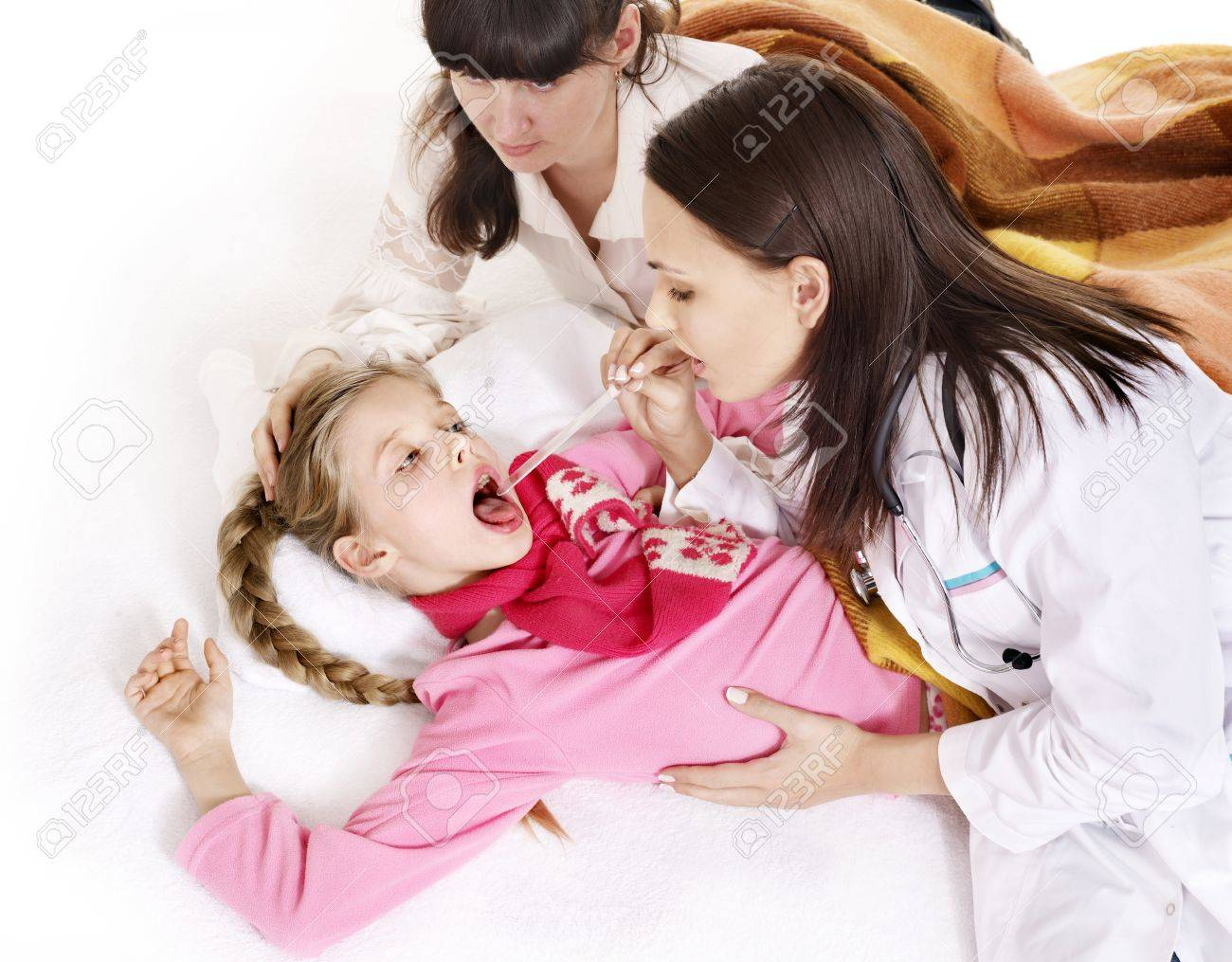Doctor examining child with sore throat. Isolated. Stock Photo - 9899441