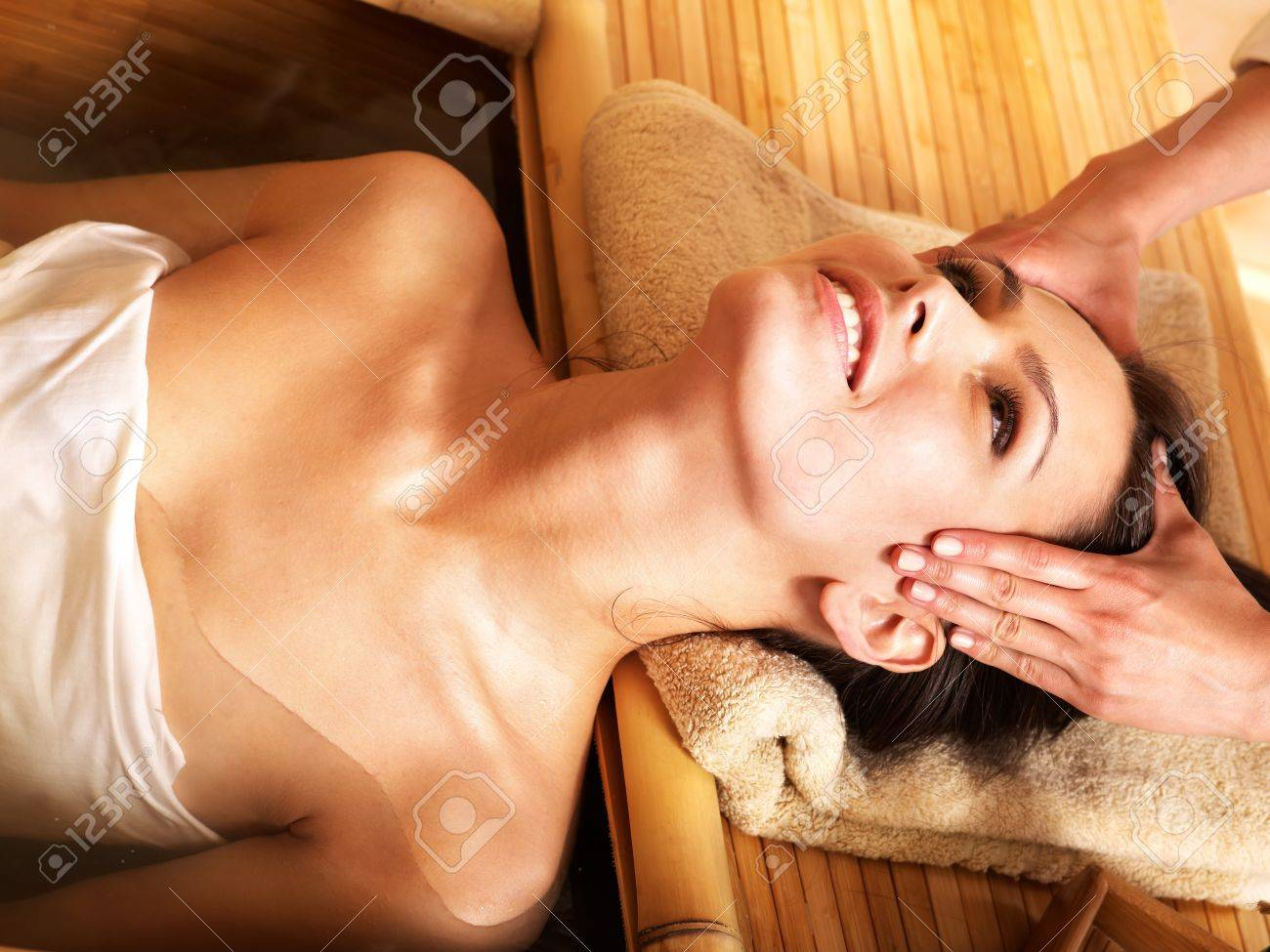 Young woman getting massage in bamboo spa. Stock Photo - 9899438