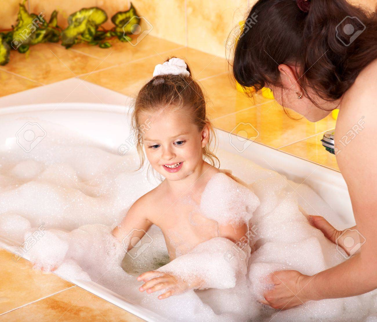 Mother and child washing in bubble bath . Stock Photo - 9899394