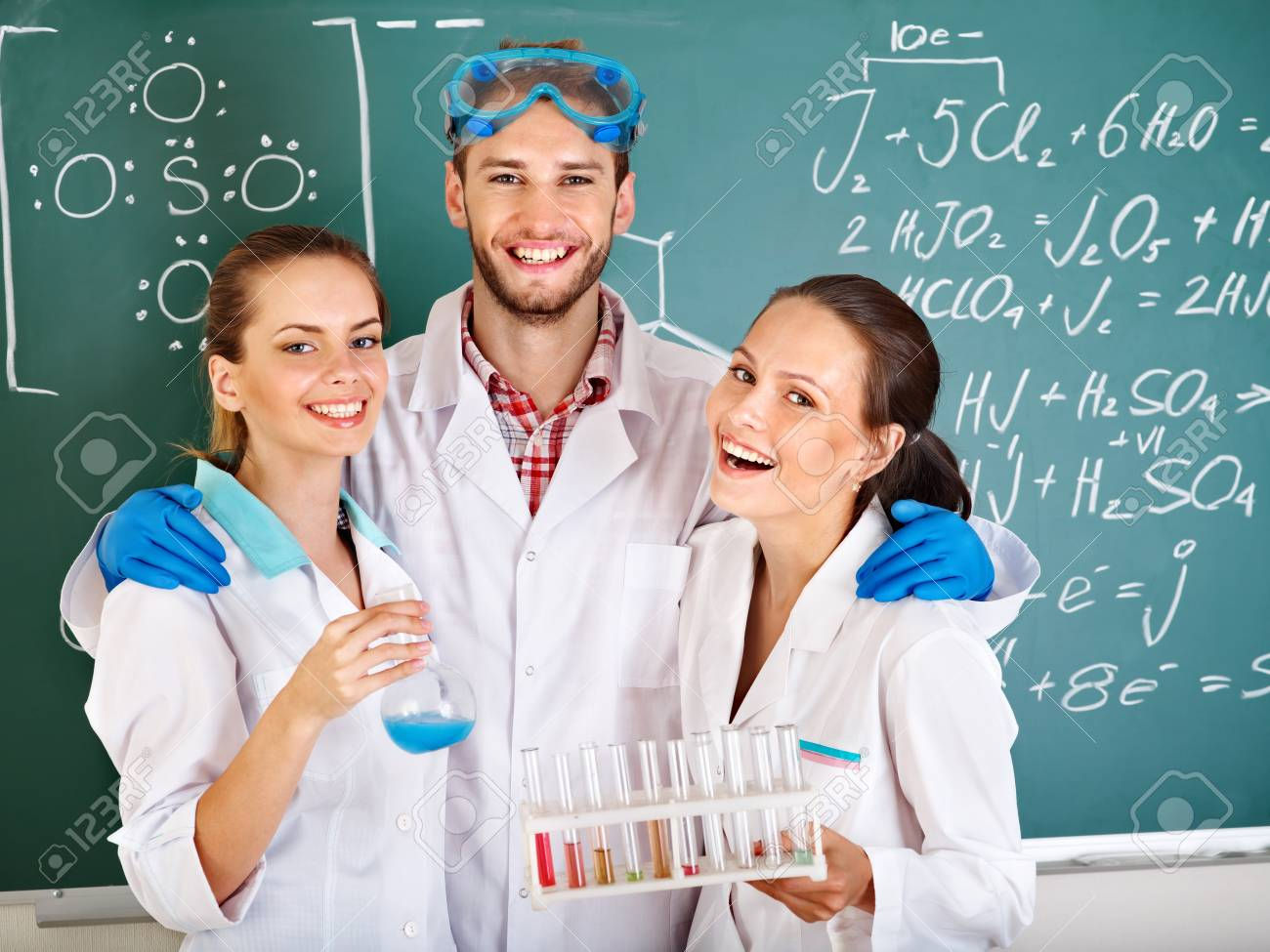 Group chemistry student with flask in classroom. Stock Photo - 10292407