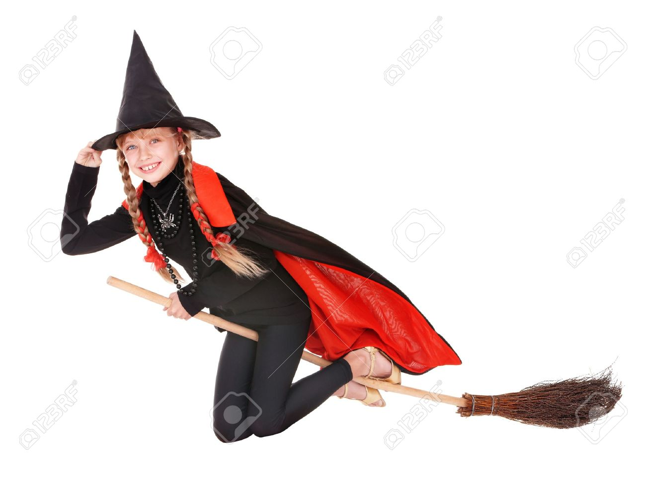 Little girl in costume Halloween witch in black dress and hat fly on broom.Isolated. Stock Photo - 10532948