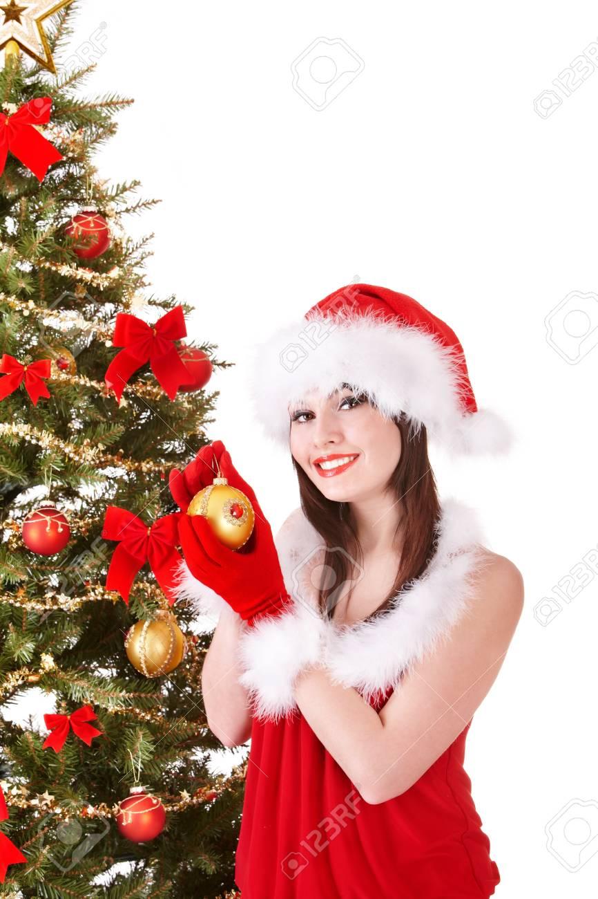 Girl in santa hat decorete christmas tree.  Isolated. Stock Photo - 10701545