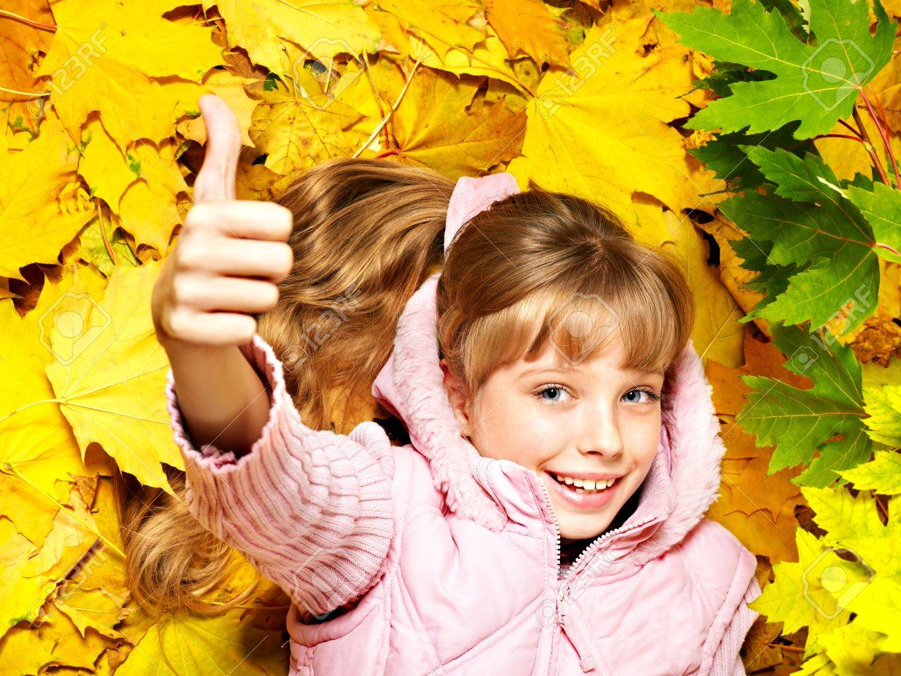 Child in autumn orange leaves. Outdoor. Stock Photo - 10701656