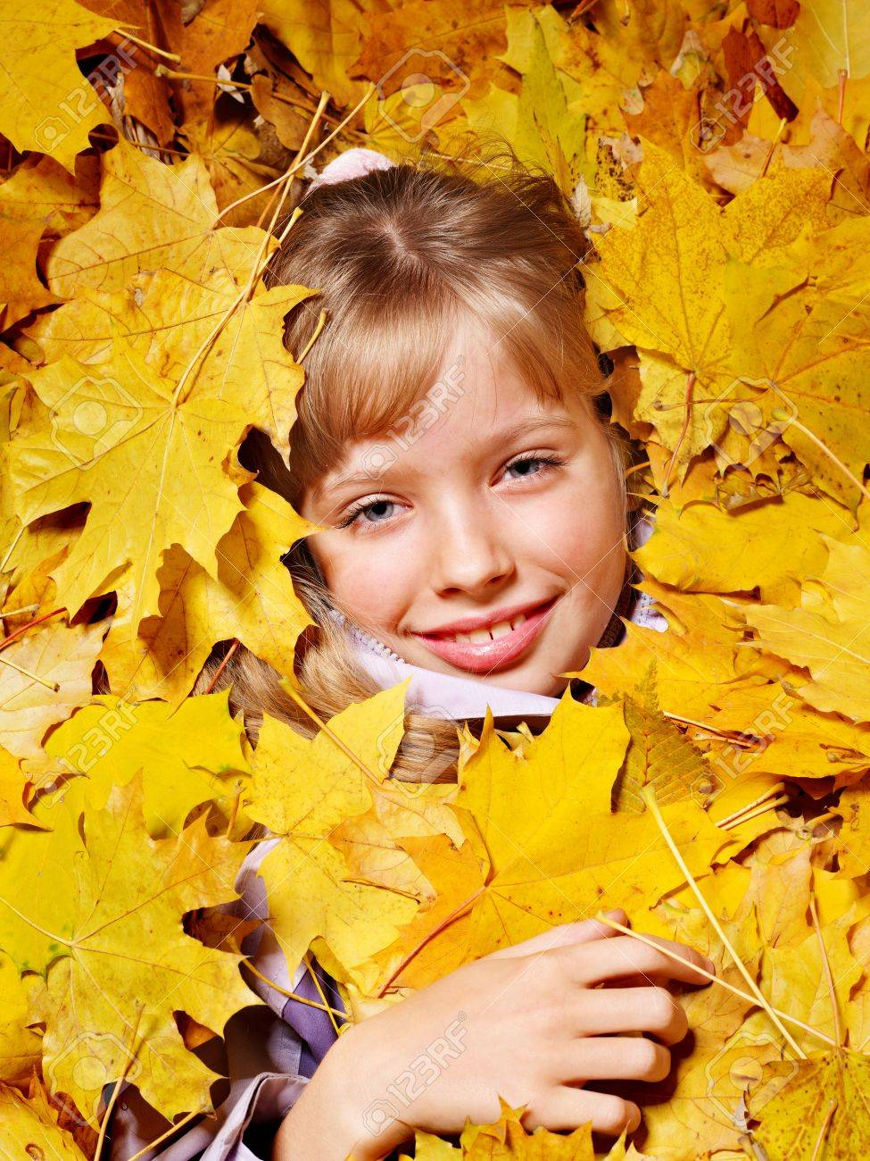 Child in autumn orange leaves. Outdoor. Stock Photo - 10701664