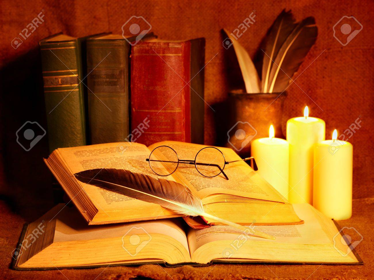 Stack old book and candle. Education. Stock Photo - 10701989