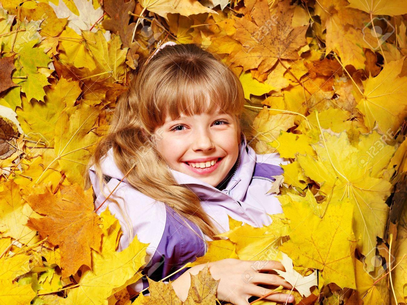 Child in autumn orange leaves. Outdoor. Stock Photo - 10853308