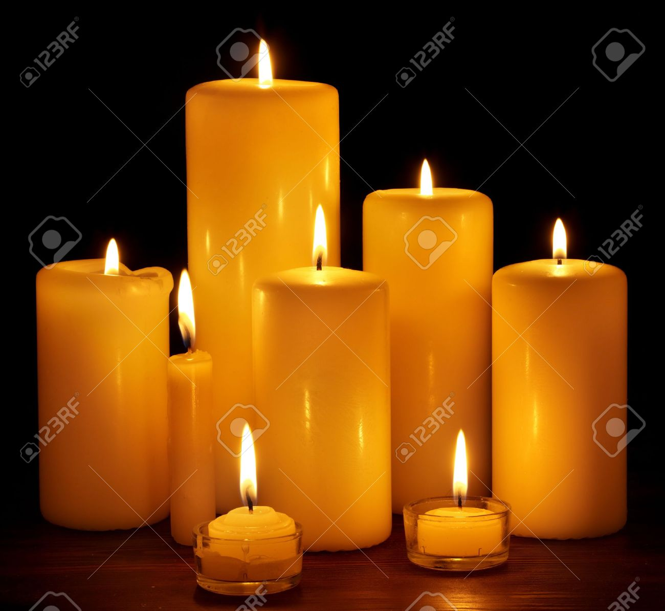 Group Of Burning Candles On Black Background. Stock Photo, Picture ...