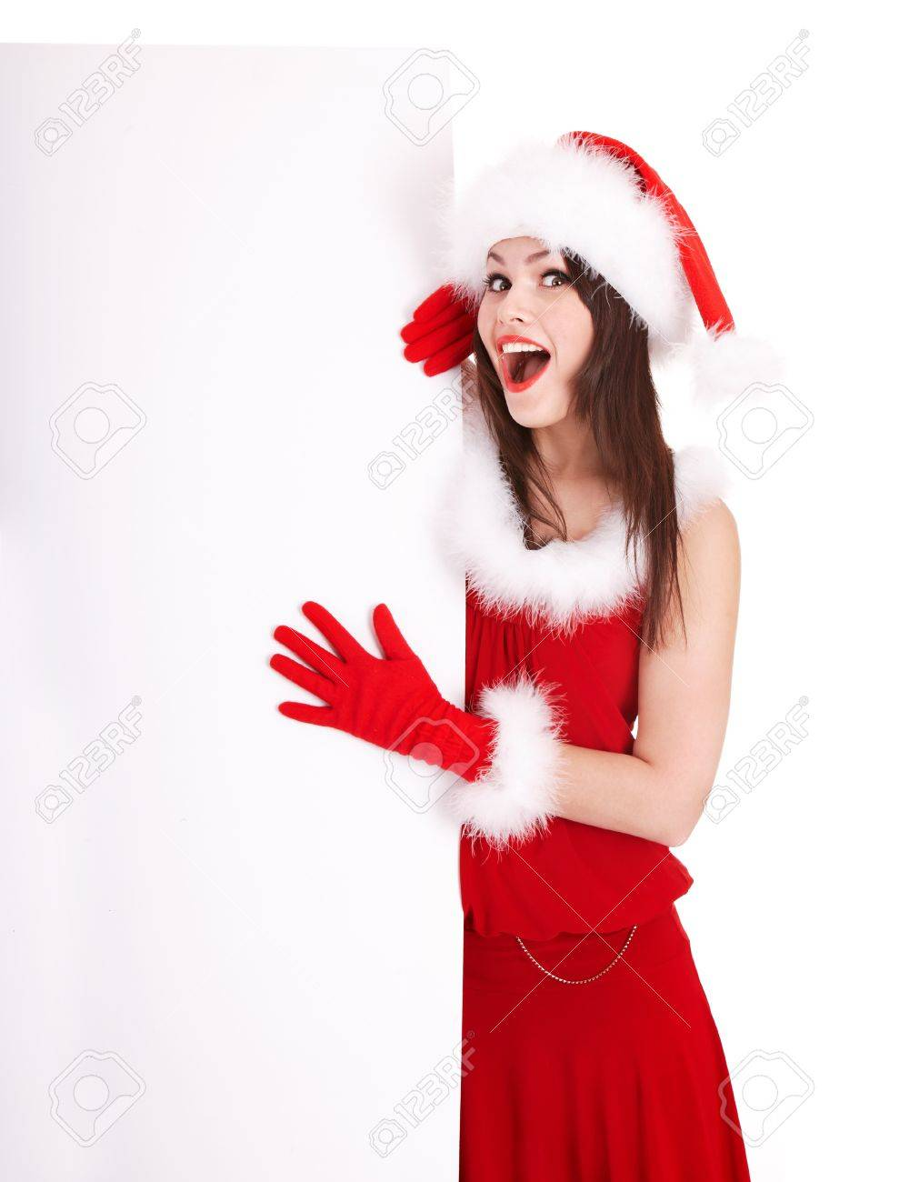 Christmas girl in santa hat holding banner. Isolated. Stock Photo - 11209931