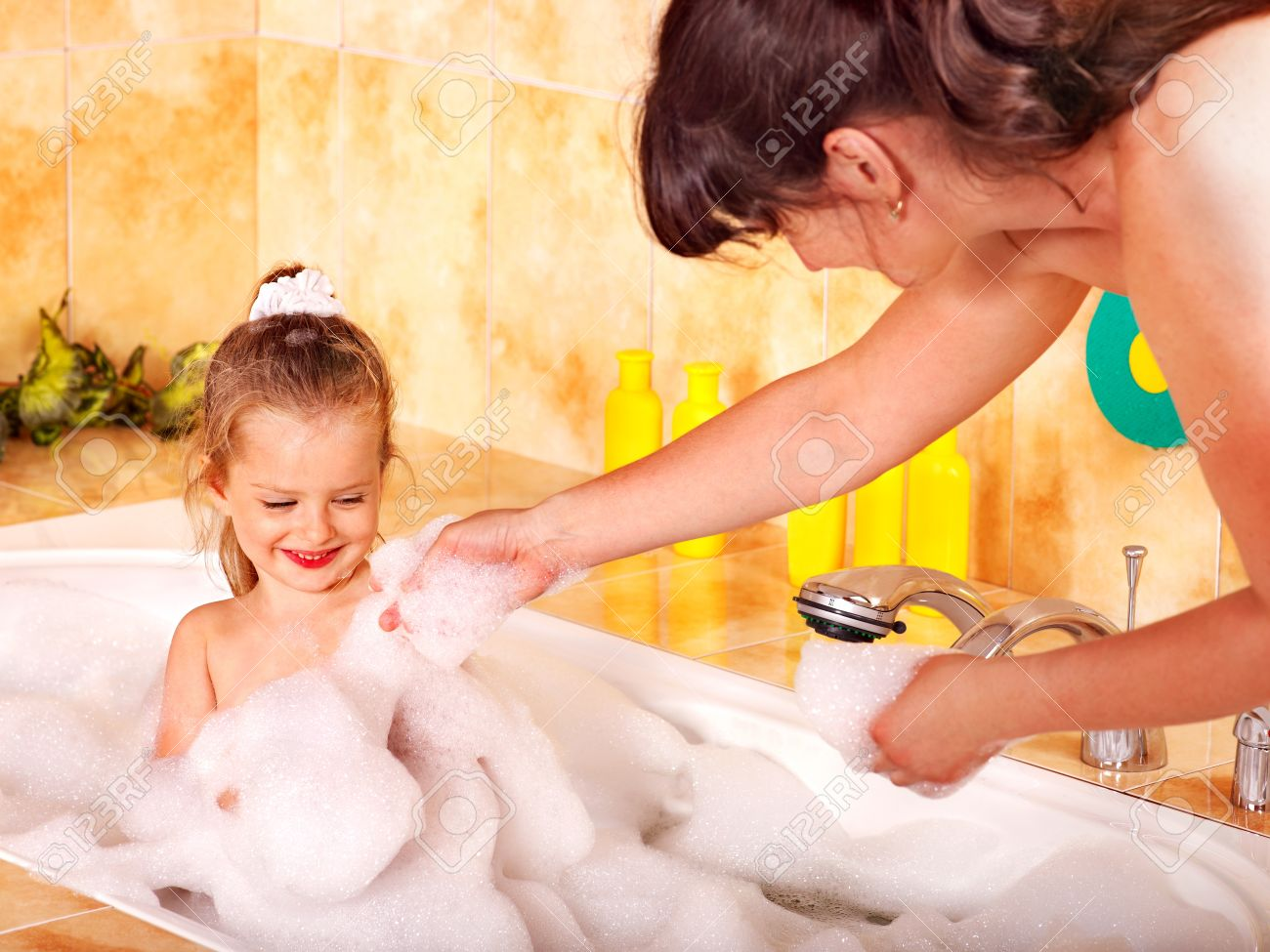 Mother and child washing in bubble bath . Stock Photo - 11216941