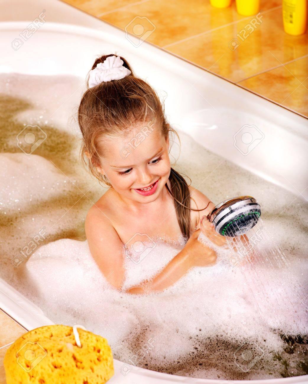 Child washing in bubble bath . Stock Photo - 11210040