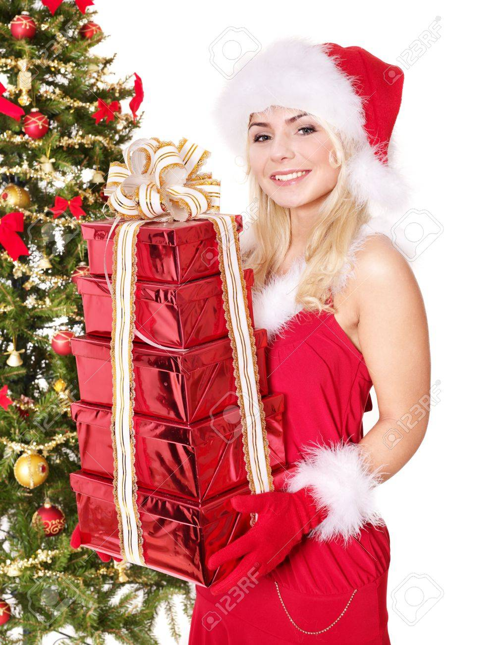 Girl in santa hat holding stack gift box near christmas tree.  Isolated. Stock Photo - 11439368