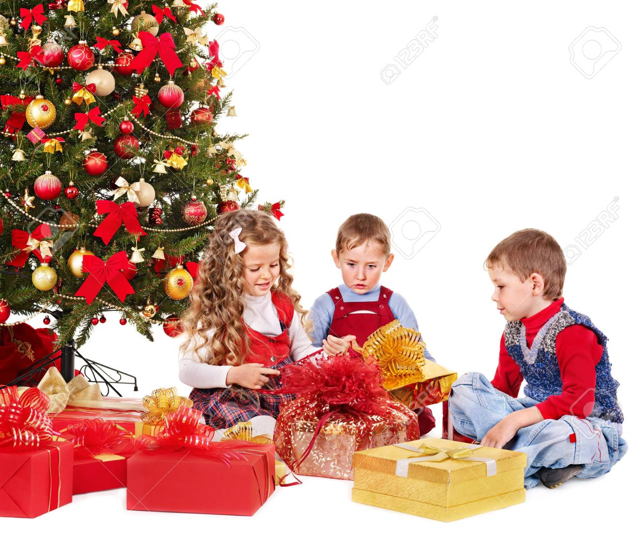 Children with gift box near Christmas tree. Isolated. Stock Photo - 11439382