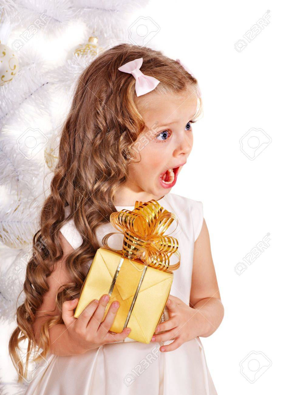 Child with gift box near white Christmas tree. Isolated. Stock Photo - 11439581
